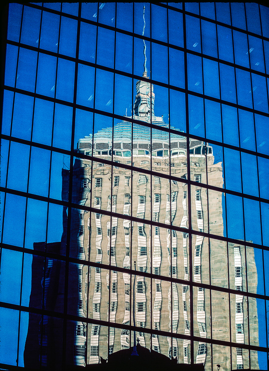 Reflection of Trinity Church on Hanckock Building