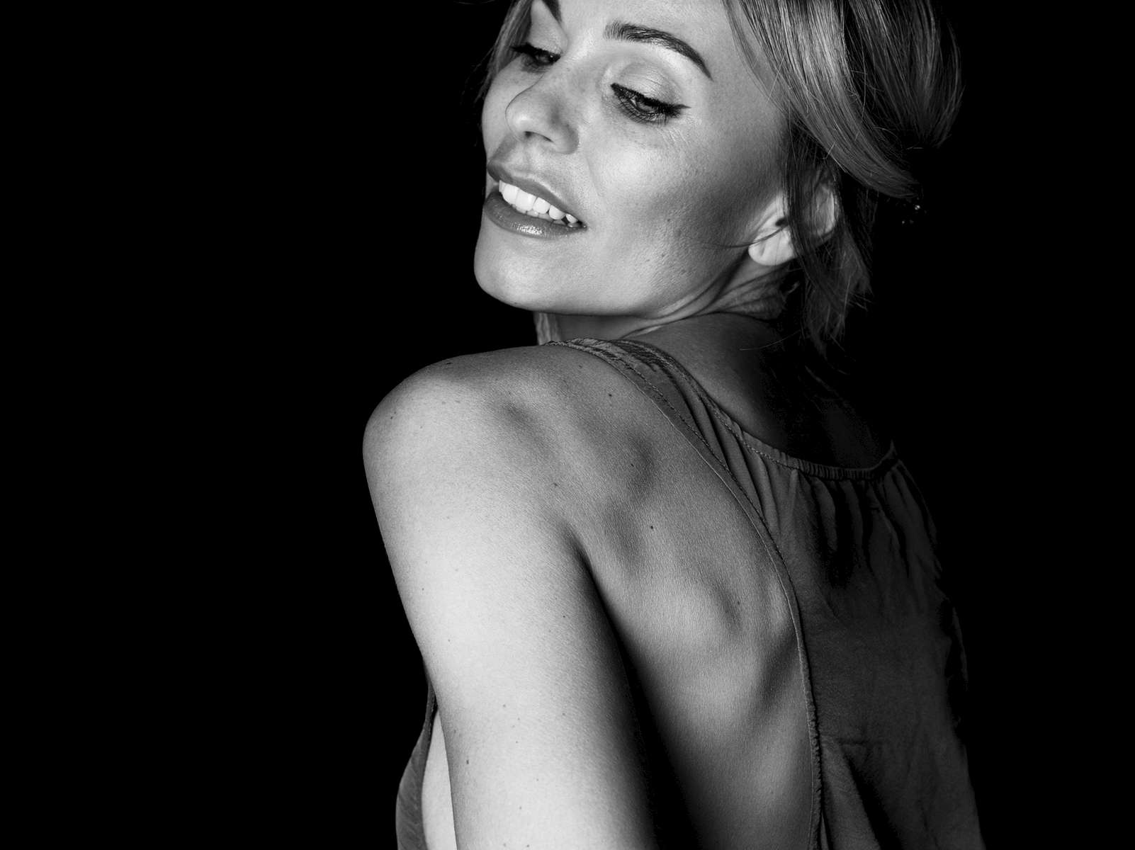 Model: Ingvill in this black and white image posing while moving away from the camera
