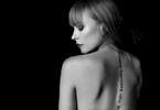 Model Ingvill posing in this black and white image with her back towards the camera