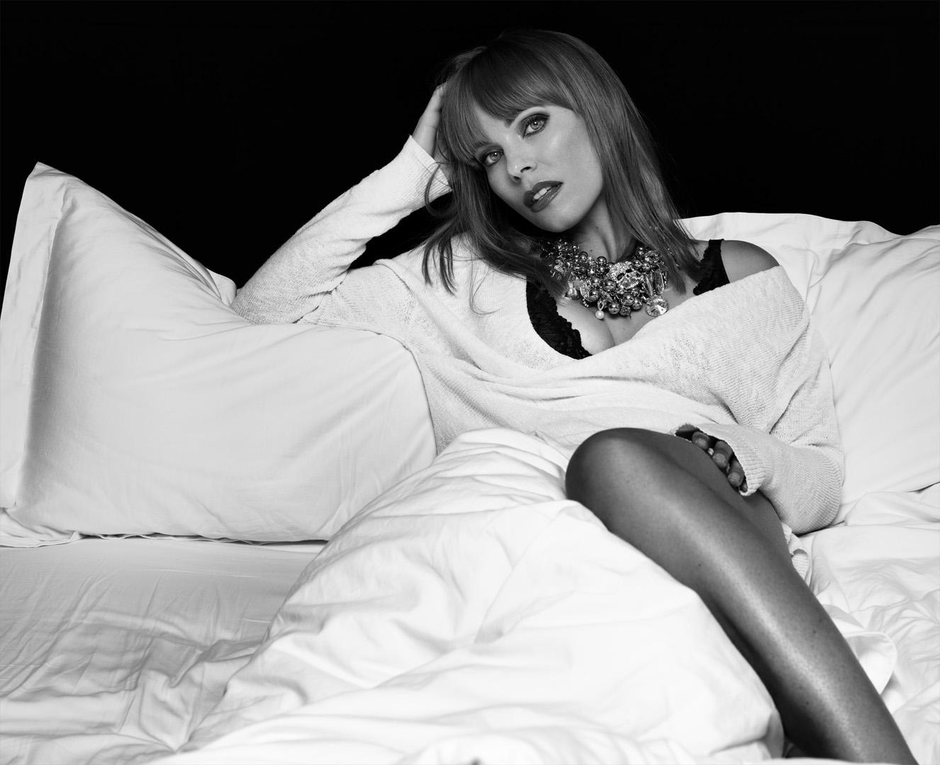Model Ingvill posing on the bed