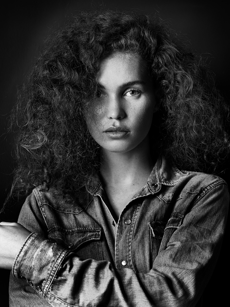Model: Sophie, black and white portrait, head and waist shot wearing a denim shirt