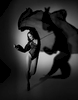 Nude model Anne Duffy. Anne is in motion whilst wearing lingerie with a black gown creating flair with the shadows