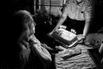 Marjorie's daughter, Mary Virginia, presents the 25th Wedding anniversary cake of Marjorie's eldest son Rowland who's name she can't remember. 1996