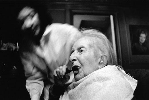 Marjorie's nurse supervises bedtime activities. 1996