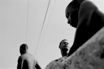 Young Haitian and Dominican boys relax on a bridge just over the Haiti-Dominican Republic border. Many Haitians cross the border into the DR to find better paying manual labot jobs. Once there, however, they often endure police harassment and discrimination. 2004