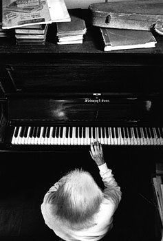 Marjorie, a self taught pianist, plays chopsticks on her piano, the only song she remembers. 1995