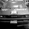 While Vodou is practiced by many in Haiti, most Haitians identify as Christian. Here a spiritually powered taxi attests to a vibrant Christian community in Cap-Haitien. Haiti 2004