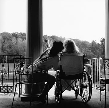 Disoriented, Marjorie listnes to her nurse describe the secne and explain that they are on the front porch of her home. 1996
