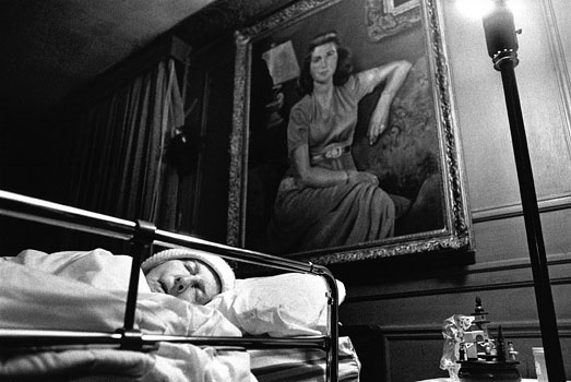 Unable to walk, Marjorie was moved downstairs in her Butler home. Ironically, she sleeps under a protrait of herself at age 24 painted by her late husband. 1996
