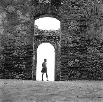 A boy walks along the ruins of San Souci, a palace built by Henri Christophe n 1810 to be the rival of the French Versailles. Milot, Haiti, 2004