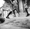 Boys play football on a side street in Cap-Haitien. Haiti 2004