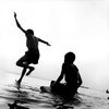 Boys play near the bank of the Ganges River.Varanasi, India 1997