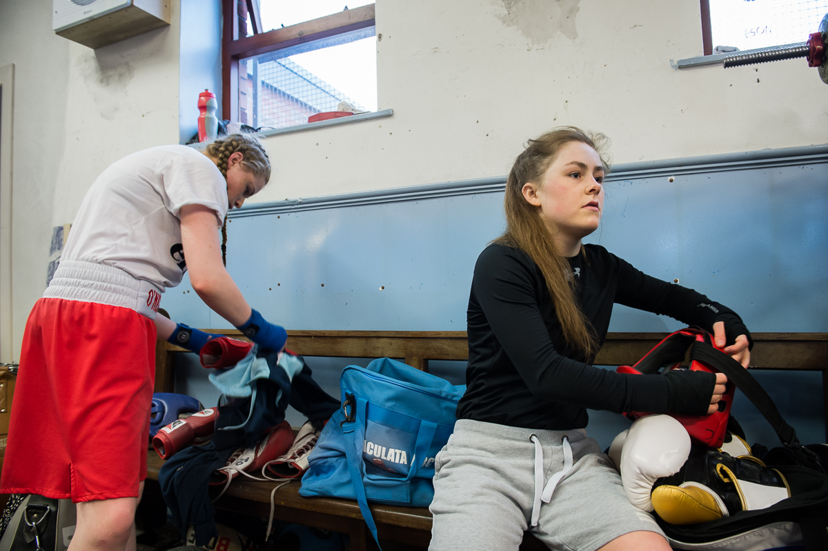 Caitlin (right), 17, and Tigernach, 14, get ready for boxing practice in the Divis Immaculata boxing club in the Catholic Divis area of west Belfast. Caitlin who already won several national and international medals, is an inspiration for the younger Tigernach.