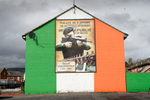 A republican mural depicting former north Belfast IRA volunteer Martin Meehan on a housing estate in the Catholic Ardoyne area of north Belfast. Northern Ireland has a long tradition of murals with paramilitary and historical narratives as dominating themes.Young people live in segregated neighborhoods where the violent past is normalized in barriers, murals and commemorations.