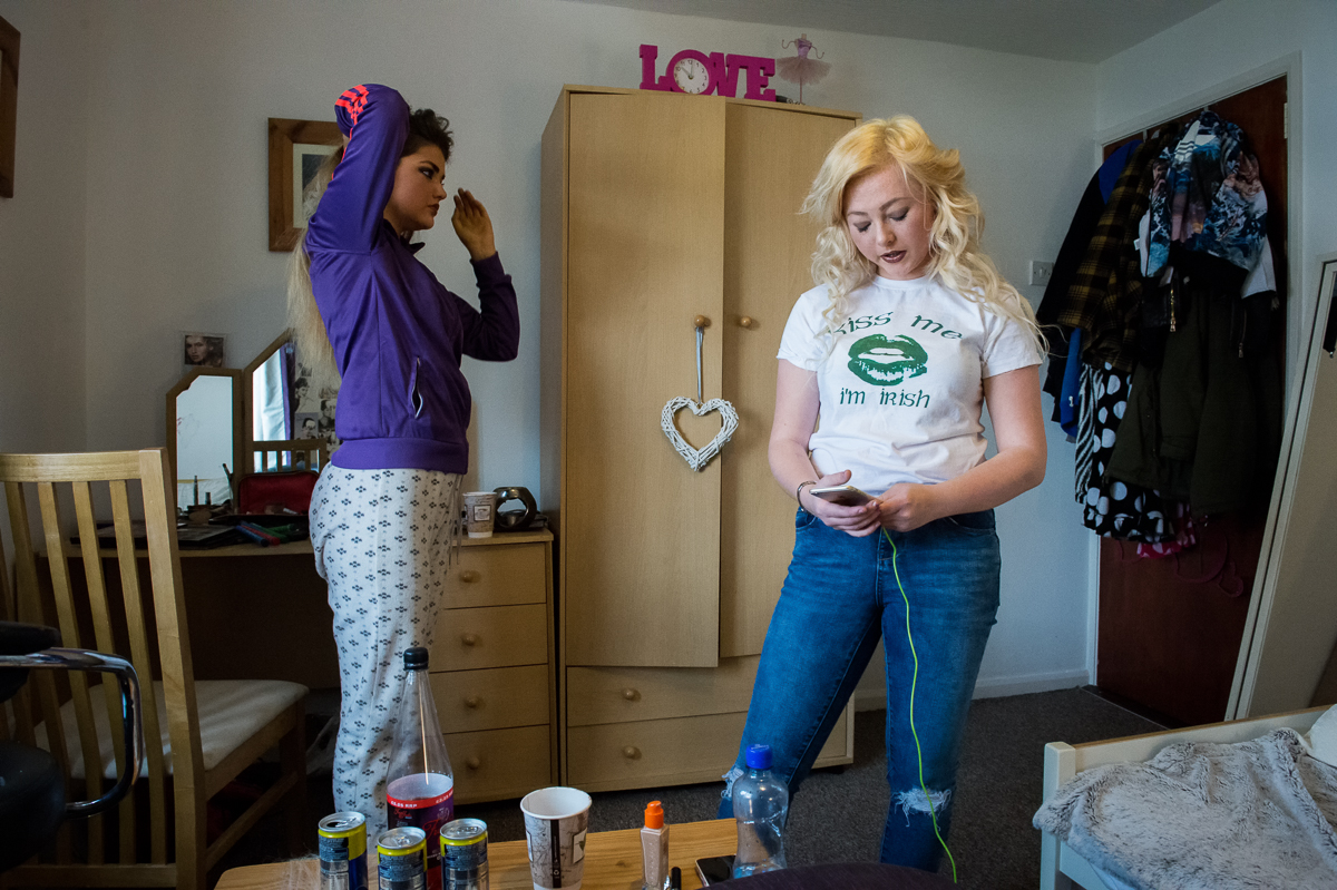 Best friends Demi (right), 17, and Briege-Anne, 16, get ready for a party, in Demi's home in the Protestant enclave of Suffolk in west Belfast. The two friends come from different communities and frequent each other's houses, still a rather exceptional situation. {quote}It's safer for girls than for boys {quote}said Briege-Anne who lives in the neighboring Catholic Lenadoon area and often visits her best friend. {quote}Boys are seen as threats, girls get away with more{quote}.