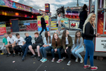 Teenagers hang out at a fun fair in the Catholic Ardoyne area of north Belfast. Traditionally the Protestant population constituted a majority in Belfast but  with the rapid increase in the Catholic population and the decline of the number of Protestants there is a shift in the city's demographic balance.