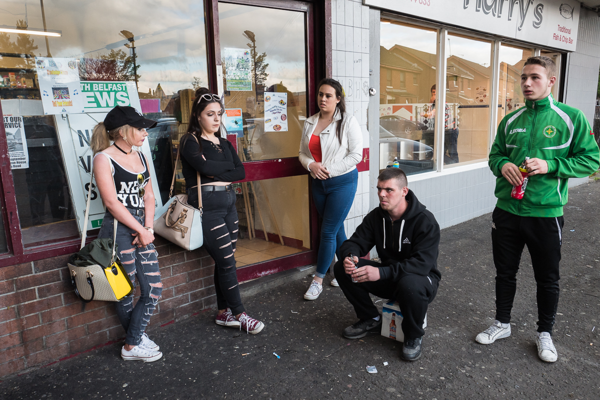 Young people wait for friends to join them before going out on a Saturday night in the Catholic New Lodge area of north Belfast. Working-class youth from both communities are often stigmatized and perceived as a problem or threat. Young people in turn feel misunderstood and undervalued.