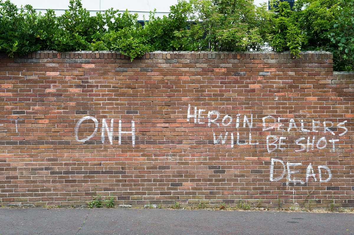 Graffiti threatening heroin dealers on a wall in the Catholic Falls area of west Belfast. The graffiti is signed by Oglaigh na hEireann (ONH) - soldiers of Ireland - a small dissident republican paramilitary group.Paramilitary activity is an enduring legacy of the Troubles. Paramilitary groups  are involved in drug trafficking, protection rackets and other criminal activities. The paramilitary groups continue to recruit young people, often through coercion or in payment for drug debts. They also engage in vigilante policing and pretend to protect their communities from alleged anti-social behavior and petty crime with their violent attacks. People, including children, from both communities have to cope with the intimidations, beatings, shootings and expulsions out of the area by the paramilitaries of their own community.