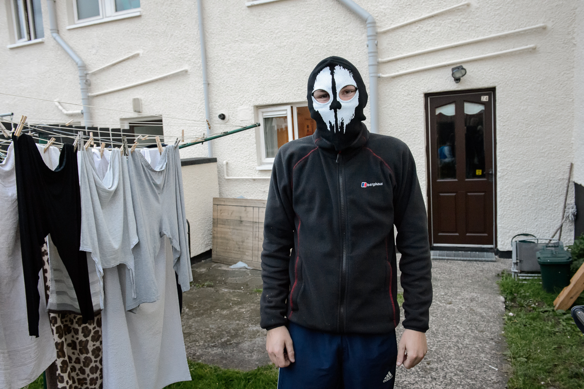 In a Protestant area, a young man shows his friends his newly bought mask which he said he might use to hide his face during rioting. The term recreational rioting has been coined to describe the violent behavior by youths out of boredom or frustration.