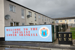 A mural indicating the presence of the UDA (Ulster Defence Association) paramilitary group in a housing estate in the Protestant Lower Shankill area in west Belfast. Next to it a smaller sign with the acronyms UFF and UYM can be seen. The paramilitary group UDA was proscribed as a terrorist organization in 1992. Earlier on, in 1973 the UFF (Ulster Freedom Fighters), a cover name used by the UDA when conducting operations, was outlawed.  The Ulster Youth Militants  (UYM) is the youth branch of the UDA. UDA/UFF terrorists were responsible for hundreds of deaths — most of them Catholic civilians — during the Troubles.Paramilitary activity is an enduring legacy of the Troubles. Paramilitary groups  are involved in drug trafficking, protection rackets and other criminal activities. The paramilitary groups continue to recruit young people, often through coercion or in payment for drug debts. They also engage in vigilante policing and pretend to protect their communities from alleged anti-social behavior and petty crime with their violent attacks. People, including children, from both communities have to cope with the intimidations, beatings, shootings and expulsions out of the area by the paramilitaries of their own community.