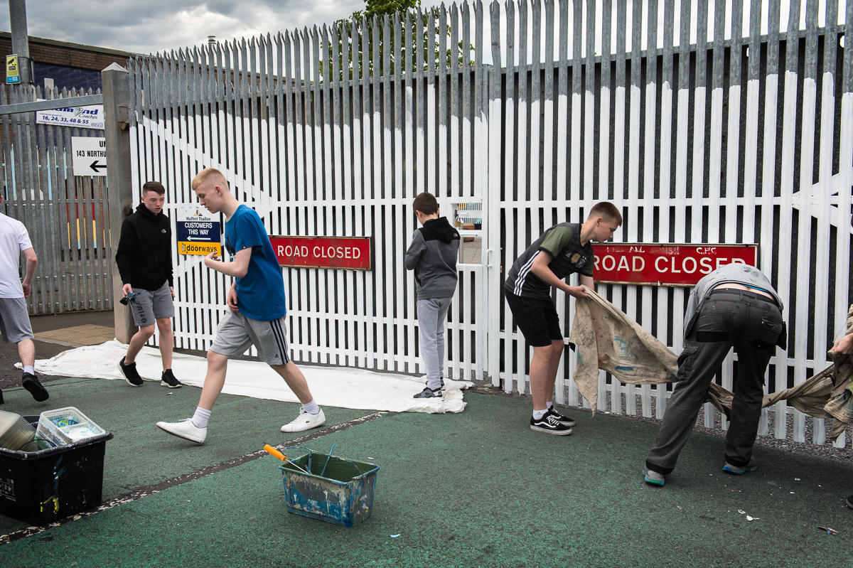 Young people participating in a cross-community project by a youth club in the Catholic Divis area in west Belfast, gather to decorate both sides of a gate between Protestant Shankill and Catholic Falls road. Every night the gate closes at 6.30pm.First built in 1969 as a temporary solution to reduce violence, the peace walls — a euphemism for segregation barriers — have increased in number and scale since the start of the peace process. The barriers take many forms: Not only walls but also fences, gates, roads and empty buffer zones divide the Catholic and Protestant communities in some of the city's most economically deprived areas. The government promised to take the barriers down by 2023, but many residents are not ready for them to come down any time soon. Not all interface areas — the common boundary between a Protestant and a Catholic area —  have a physical border. Sometimes there is only an invisible dividing line that local people are aware of.