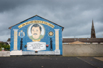 A UDA/UFF paramilitary mural in the Protestant Lower Shankill area of north Belfast honoring a killed member.  The paramilitary group UDA (Ulster Defense Association) whose slogan is {quote}QS{quote} (Quis Separabit)  - who will separate (us) - was proscribed as a terrorist organization in 1992. Earlier on, in 1973 the UFF (Ulster Freedom Fighters), a cover name used by the UDA when conducting operations, was outlawed. UDA/UFF terrorists were responsible for hundreds of deaths, most of them Catholic civilians, during the Troubles. Now, the  UDA/UFF has evolved into a criminal organization engaged in drug trafficking, protection rackets and other criminal activities. And like the other paramilitary groups in Belfast, they are also involved in vigilante activities and pretend to protect their communities from alleged anti-social behavior and petty crime with their violent attacks. People, including children, from both communities have to cope with the intimidations, beatings, shootings and expulsions out of the area by the paramilitaries of their own community.