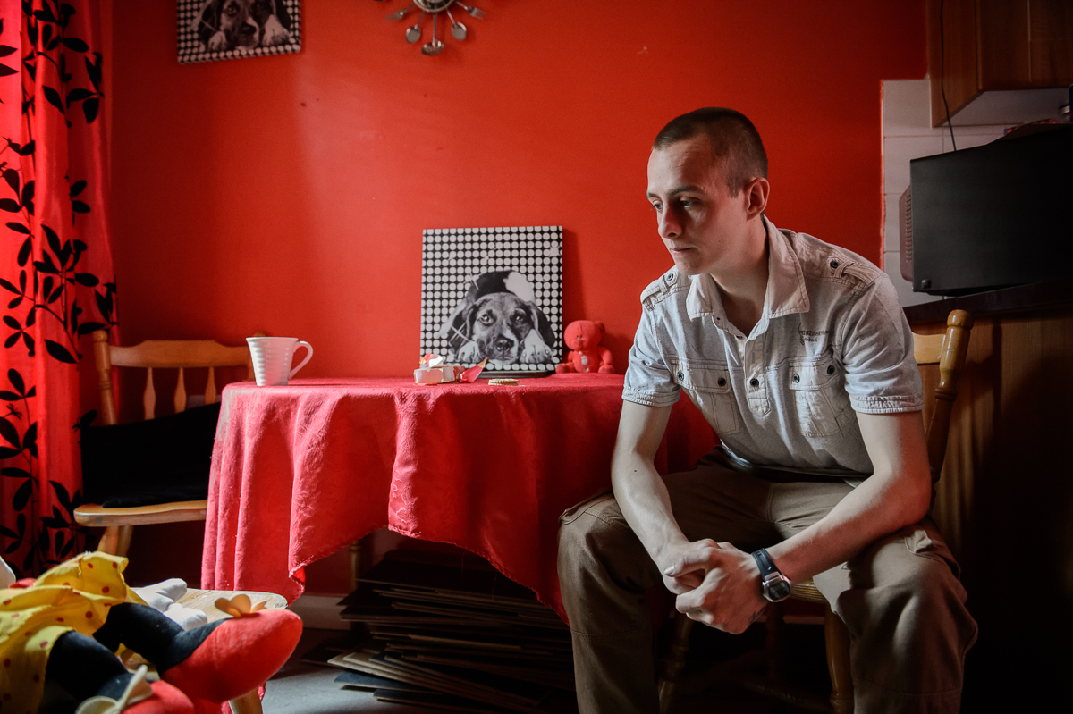 Stephen, 25, who is unemployed, sits in the living room of the house in the  Protestant Roden Street area of south Belfast where he lives with his wife and three children.  {quote}They're trying to take our culture away.{quote} he said, expressing a general sense of unease among young working-class Protestants.