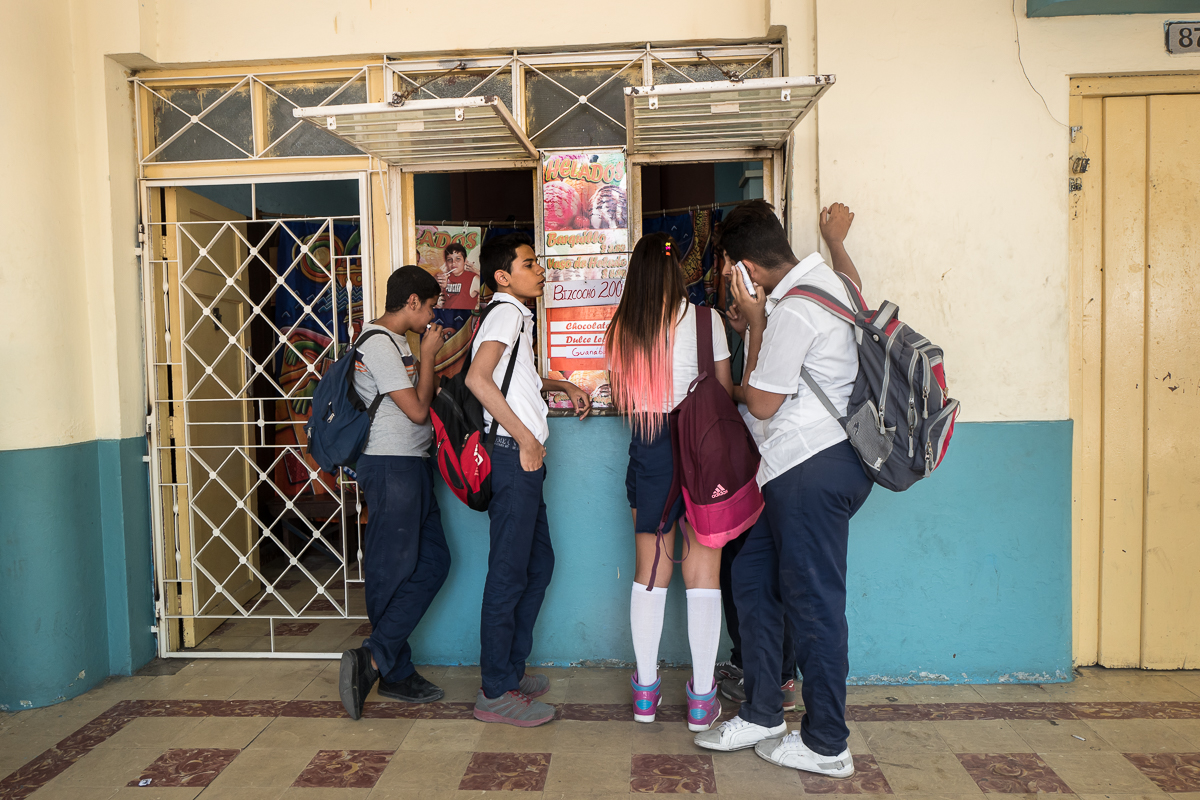 Centro Habana, Havana   After school, high school students stand at an ice-cream shop in Centro Habana. Frustrated by an inverted social pyramid in which the high earners are not the most educated, young people are increasingly discouraged to start higher education. Most of the professions opened up to self-employment do not require any higher education.