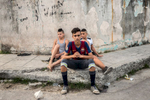 El Canal, Havana    Dariel González Colado (middle), 17, and neighbors Felix (left), 15 and Albaro, 13, sit on a street corner in the poor run-down neighborhood El Canal, one of the rougher neighborhoods in Havana. {quote}That's what we do every day {quote} said Dariel, who studies catering {quote}sit here or play soccer on the street, there is not much else to do{quote}.