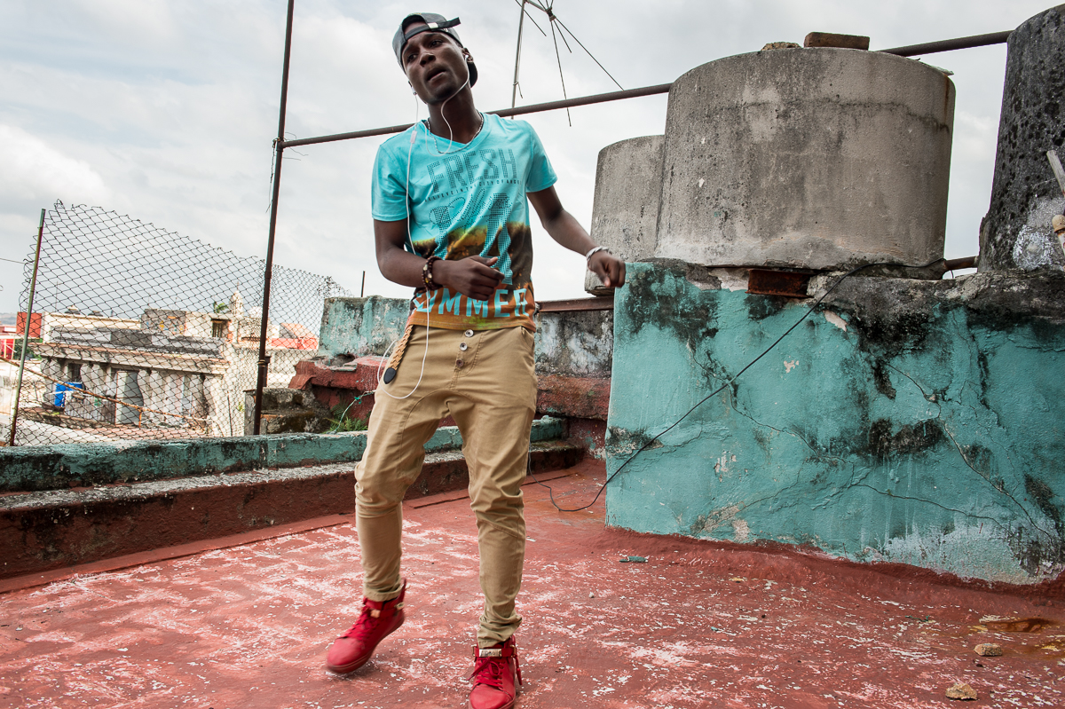 Habana Vieja, Havana   On a rooftop in the Habana Vieja neighborhood, Cristian Ramon  Kindelán, 17, - stage name El Yabo- , dances to a song by the Reggeaton band he put together with 3 friends. Reggeaton music is highly popular in Havana. Back in 2011 the government considered it a menace to the richness of Cuban music and tried to stop it. But this music genre survived and the government relaxed its restrictions. Now reggeaton music and its fashion influence are everywhere in Havana.