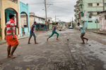 Marianao, Havana   Teenagers play soccer barefoot in the streets of the Marianao  municipality. Since a few years, soccer is becoming increasingly popular and seems to be replacing baseball as the number one favorite sport in Cuba. This popularity is partly due to the decision to broadcast European soccer games on Cuban television.