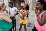 Atarés, Havana   Shanelis Moré Figuesoa (right) ,18, Yenlys Peña Garcia (left) 18 and two neighbors, stand on the street in the low-income  Atarés neighborhood, one of the rougher ones in Havana. On the streets of poor neighborhoods, there is little excitement about economic reforms and warming relations with the U.S.  The economic reforms risk deepening the rift between the rich and poor.