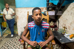 Centro Habana, Havana   Yorlanis Veitia , 16,  sits in a rocking chair in the living room of the small house where he lives with his mother who works in  a state-owned fast food restaurant. They have a hard time meetings ends. An average state salary is less than $20 and even though most people find a way to make some money on the side, having enough to satisfy all necessities is often a struggle.