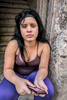 Centro Habana, Havana   Gloria Cespedes Peñalver, 18, who is unemployed, poses for a portrait on the stairs her apartment building in the Centro Habana neighborhood.  Economic reforms have left disproportionally more women out of work.