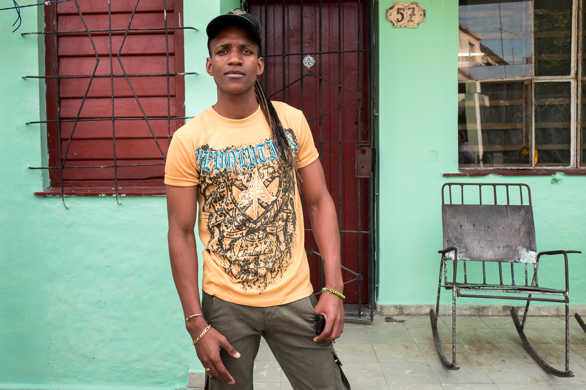El Cerro, Havana   Yulien, 25, poses for a portrait in front of his house in the El Cerro municipality.