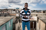 El Cerro, Havana   Samuel Enrique Acuna Teran, 18, poses with a pigeon on the roof of his family' house in El Cerro municipality. He put his civil engineer studies on hold to pursue a career as a reggeaton singer.