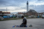 Calais, February 2014 Shawkan Aziz (20), who left Afghanistan six months earlier, prays at dusk.