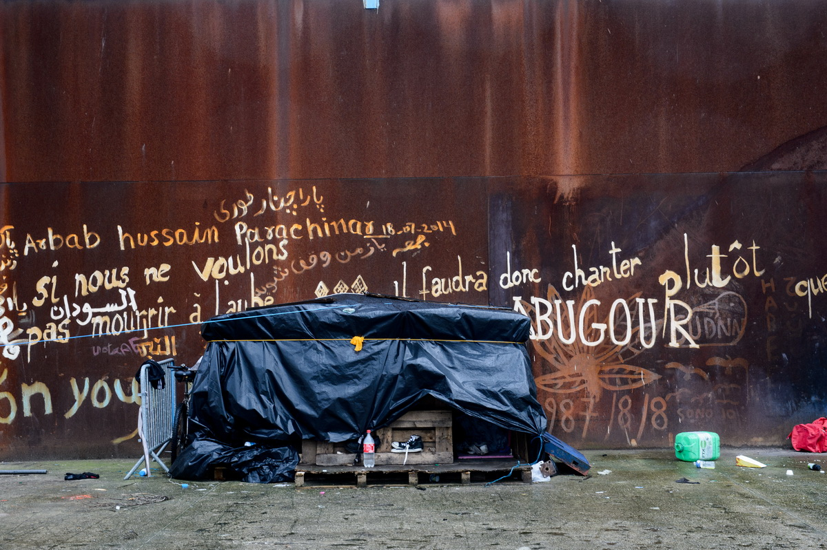 Calais, December 2014 A makeshift shelter made of plastic sheeting and packing crates stands on the site of Galoo squat, an abandoned metal recycling plant.