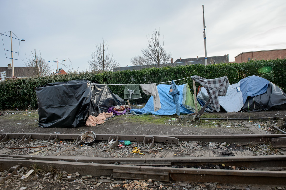Calais, February 2014 Tents stand on a disused railway line in Calais just beside the main port from where ferries leave for the UK. The tents are reinforced against the elements by plastic sheets, tarpaulins, wooden pallets and railway line ballast. In May 2014, police used bulldozers to dismantle three makeshift camps around the town, claiming that an outbreak of scabies threatened public health. Since then, several new camps have sprung up to shelter the refugees and migrants who keep arriving in increasing numbers.
