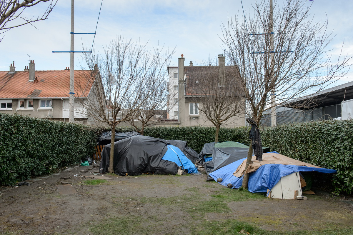Calais, February 2014 Tents stand in a small park, not far from the port of Calais.  In and around Calais, tents and shanties are spread out on the coast and the main road axes for lorries heading to the UK. In May 2014 police used bulldozers to dismantle three makeshift camps around the town, claiming that an outbreak of scabies threatened public health. Since then, several new camps have sprung up to shelter the migrants who keep arriving in increasing numbers.