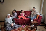 Confined to his apartment because of his disease, Bekir spends most of his days on the sofa.  Here he drinks tea surrounded by his wife Zeynab, daughter Tugba and her friend.