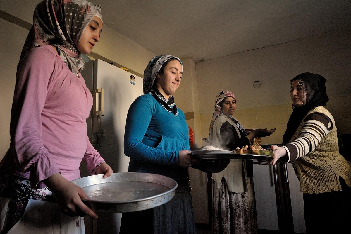 Women of the Basak family serve dinner.