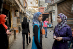 Marwa Hazineh (13) and her friends Asmaa, Esraa and Arej, all of them Palestinian refugees from Syria, stand on a street in Shatila. Except Marwa, none of the girls go to school anymore.