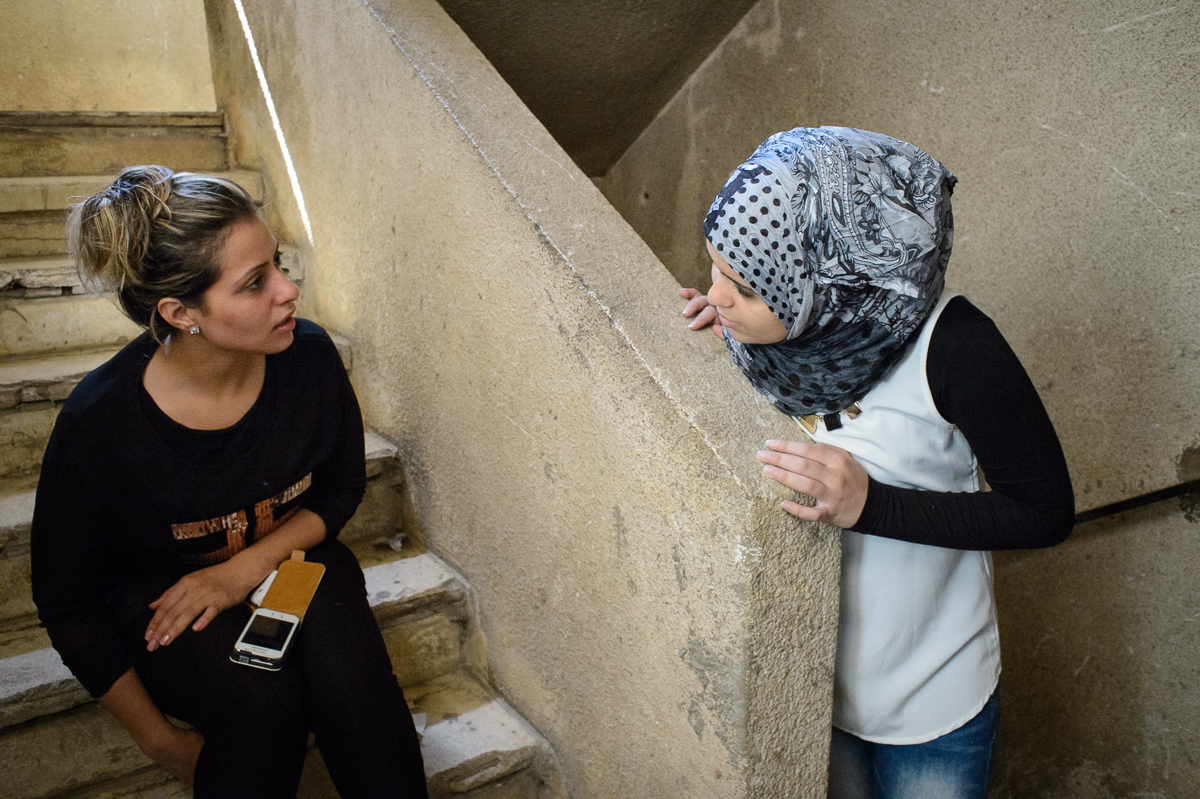 Fatima Gazzawi(16) talks to her friend Heba(25), a Pal-estinian refugee from Syria. Fatima who loves science still hasn't decided if she wants to become a medical doc-tor or a civil engineer.