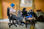 On a visit to the house of the Abed El Hade family, Fati-ma Gazzawi (16) drinks tea with her friend Fatima (17) and her family.