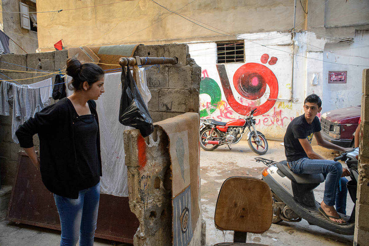 Nirmeen Hazineh (15), who wants to study political sci-ence, talks to her brother in front of the two-room house the family of nine lives in.