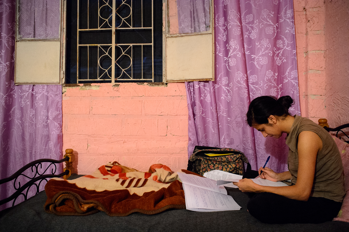 Nisreen Hazineh (18) studies on her bed. She wants to become a film director.