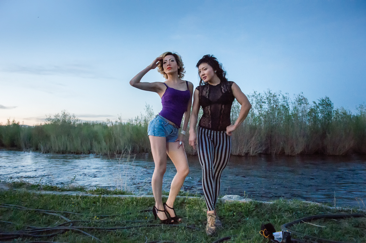 Young women pose for a photo at River Beach, a resort on the bank of the river Tuul. Located on the outskirts of the city, it's a hangout place for young people.