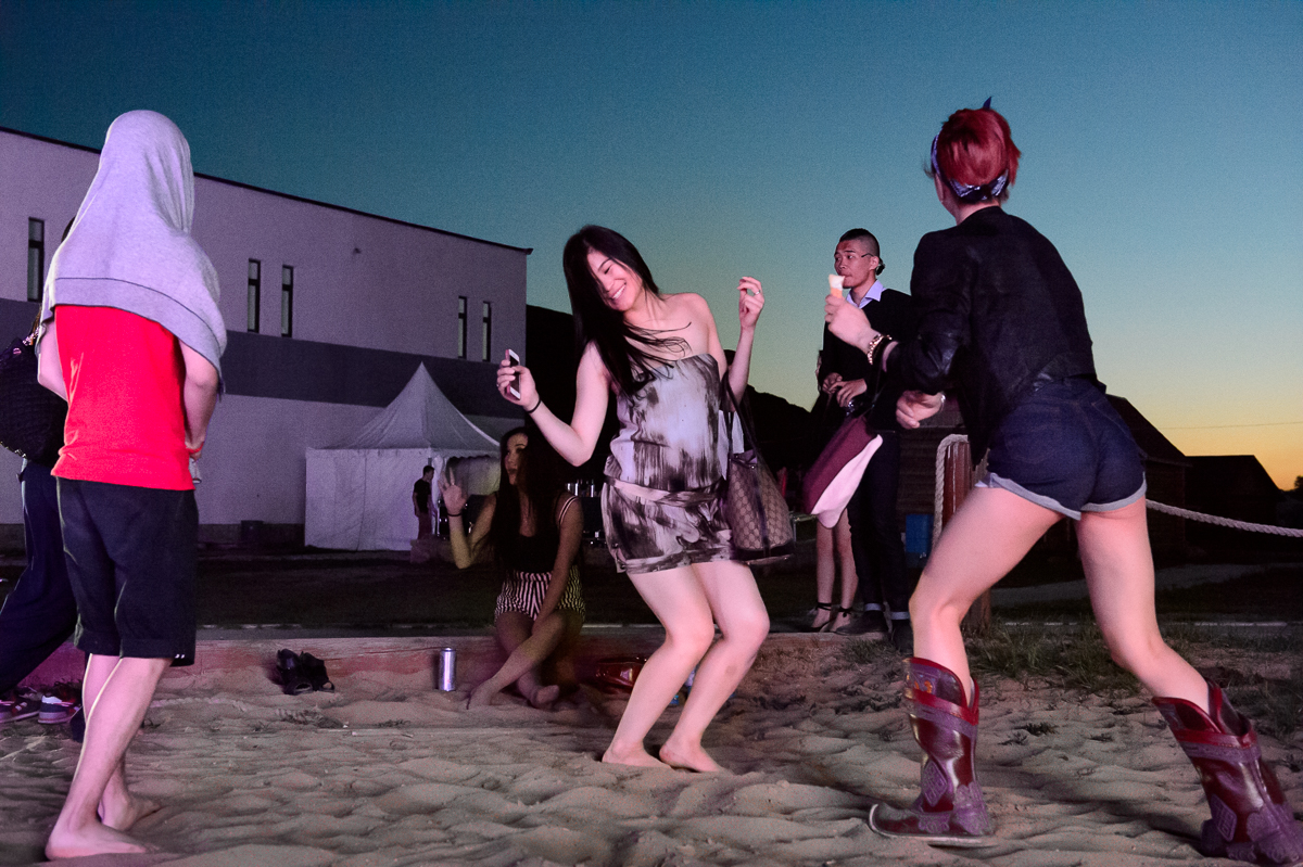 Young people dance at a party at River Beach, a resort on the outskirts of Ulaanbaatar, or UB as it is called by locals.  Hip-hop, electronic music and punk are popular music genres among the young population.