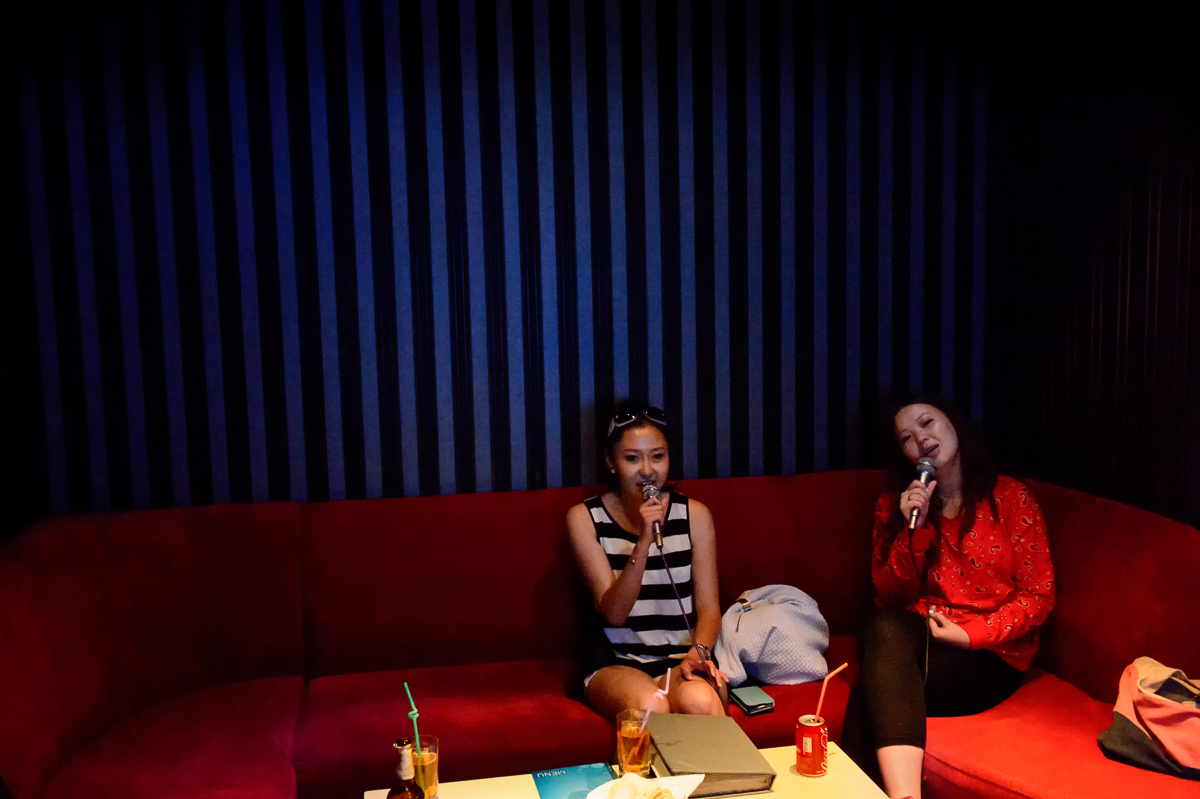 Namuunbaigali (23), a physical therapist, and Nomundelguur (24), a musician of the Morin Khuur, a traditional bowed string instrument, sing at a karaoke bar in downtown UB; karaoke is a favorite pass time in Mongolia.